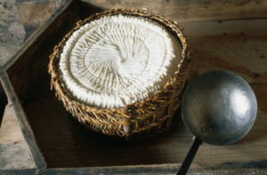 ca. 1988-1998 --- Basket of Ricotta Cheese --- Image by © Jacqui Hurst/CORBIS